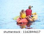child boy on kayak saving... | Shutterstock . vector #1162844617