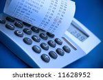 Checking supermarket cash register receipt with calculator - stock photo