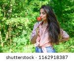 seductive appetite. girl holds... | Shutterstock . vector #1162918387