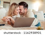 cheerful young couple using... | Shutterstock . vector #1162938901