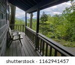wooden chair in the porch of a... | Shutterstock . vector #1162941457