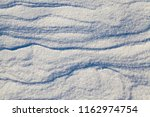 snow lying in snowdrifts after...   Shutterstock . vector #1162974754