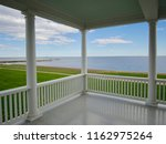 porch view of the ocean from a... | Shutterstock . vector #1162975264