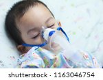 2 years old asian toddler boy... | Shutterstock . vector #1163046754