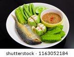 Stock photo fried mackerel with shrimp paste sauce and deep fresh vegetables famous thai spicy food nam prik 1163052184