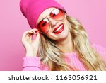 cool cheerful girl with bright... | Shutterstock . vector #1163056921