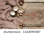 warm soft blanket  candles  dry ... | Shutterstock . vector #1163090587