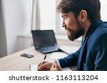 business man with beard writes... | Shutterstock . vector #1163113204