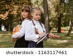 schoolgirls do homework in... | Shutterstock . vector #1163117461