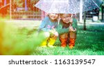 happy children under summer... | Shutterstock . vector #1163139547