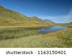 red tarn beneath crinkle crags  ... | Shutterstock . vector #1163150401