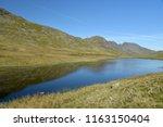 red tarn beneath crinkle crags  ... | Shutterstock . vector #1163150404