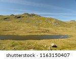 red tarn beneath crinkle crags  ... | Shutterstock . vector #1163150407