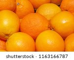 close up of oranges on market | Shutterstock . vector #1163166787