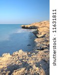 Small photo of Rocky beach on the edge of the desert at Dukhan (Dugan) in Qatar, Middle East. Sunset hour, HDR type image.