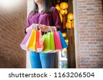 consumerism woman holding many... | Shutterstock . vector #1163206504