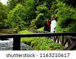 lovely arabian couple in...   Shutterstock . vector #1163210617