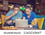students group eating pizza in...   Shutterstock . vector #1163210647