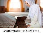 young muslim woman praying in...   Shutterstock . vector #1163211211