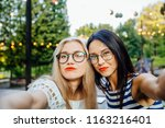 party  hangout for two young... | Shutterstock . vector #1163216401