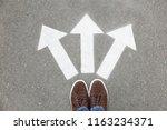 woman standing near arrows on... | Shutterstock . vector #1163234371