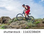 cyclist riding down the rock on ... | Shutterstock . vector #1163238604