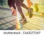 runners in  a bright light   Shutterstock . vector #1163277247