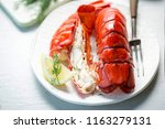 cooked lobster tails with lemon ... | Shutterstock . vector #1163279131