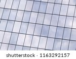 reflection of sky in windows of ... | Shutterstock . vector #1163292157