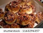 pecan topped sticky cinnamon bun | Shutterstock . vector #1163296357