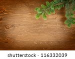 fir tree on the wooden background - stock photo