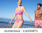 couple enjoying beach holiday   Shutterstock . vector #116334871