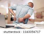 Small photo of Business man with back pain sin an office . Pain relief concept