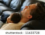Baby Asleep On His Father's...