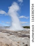 Small photo of the outburst of a geyser, Iceland