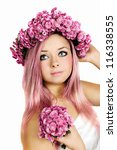 Pink-haired woman wearing a wreath of chrysanthemums - stock photo