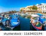 fishing boats moored in kyrenia ... | Shutterstock . vector #1163402194