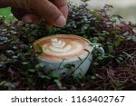 a cup of hot latte coffee cup | Shutterstock . vector #1163402767