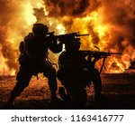 silhouettes of two army... | Shutterstock . vector #1163416777
