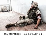 soldier in combat uniform and... | Shutterstock . vector #1163418481