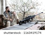 navy seal sniper in battle... | Shutterstock . vector #1163419174