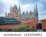 Small photo of London's British Library facade with the St Pancras Renaissance Hotel towering out above it