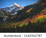 a rainbow of fall autumn colors ... | Shutterstock . vector #1163562787