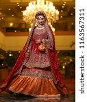desi bride wearing beautiful... | Shutterstock . vector #1163567311