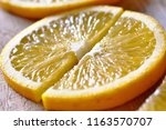 the orange is sliced into two... | Shutterstock . vector #1163570707