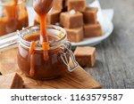 homemade salted caramel sauce... | Shutterstock . vector #1163579587