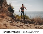fit woman running up the... | Shutterstock . vector #1163600944