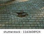damaged asphalt road with... | Shutterstock . vector #1163608924