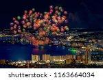 summer firework festival in... | Shutterstock . vector #1163664034