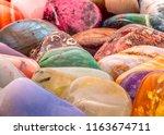 various tumbled gemstones... | Shutterstock . vector #1163674711